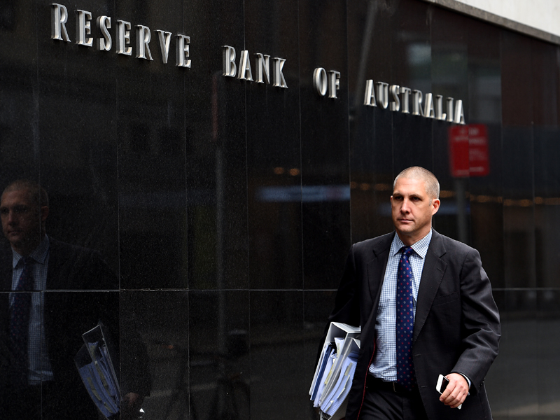 Pedestrians are seen walking past the Reserve Bank of Australia (RBA) in Sydney, Tuesday, April 7, 2015. Economists are tipping the Reserve Bank to cut the official cash rate to a record low of two percent at it's meeting today. (AAP Image/Dan Himbrechts) NO ARCHIVING