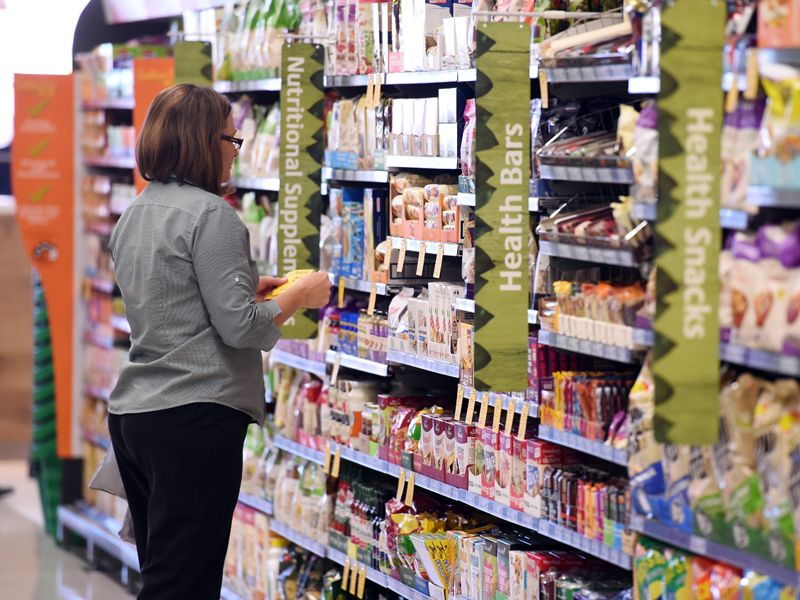 A stock image of an employee putting price tags on shelves at a product isle in a new Woolworths supermarket in Everton Park in Brisbane's northern suburbs, Monday, May 11, 2015. (AAP Image/Dan Peled) NO ARCHIVING