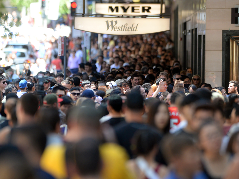 Australian consumers at the Pitt Street mall, in Sydney, Friday, Dec. 26, 2014. Consumers are expected to spend more an estimated $2.07 billion dollars in retail sales across Australia today. (AAP Image/Sam Mooy) NO ARCHIVING