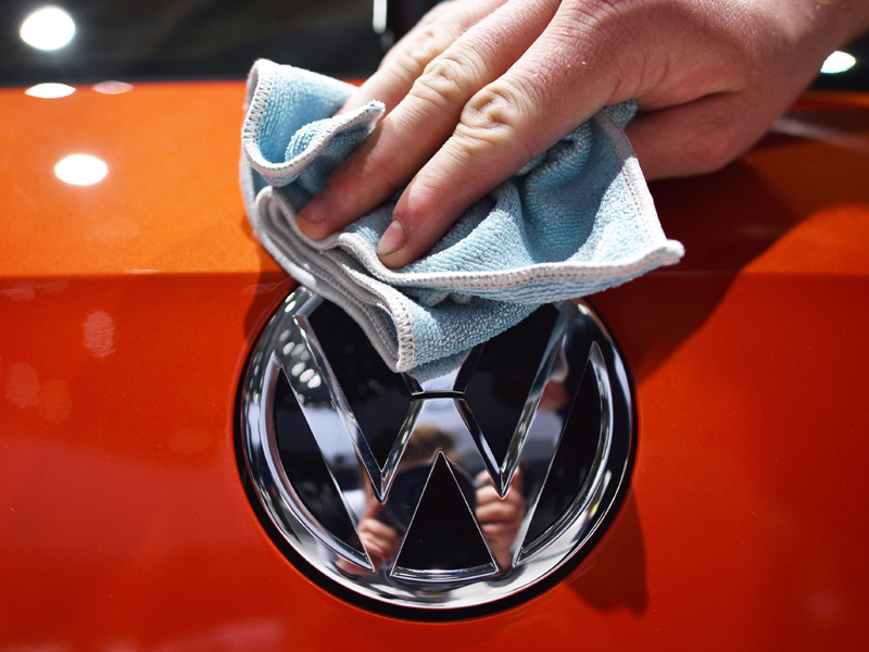 epa04863569 (FILE) A file photo dated 05 May 2015 showing an assistant polishing a VW logo at the Volkswagen AG shareholders' meeting at the fairground in Hanover, Germany. Germany's Volkswagen has taken the crown as the world's top carmaker after its sales overtook those of Japanese rival Toyota during the first half of the year, it was reported 28 July 2015. Toyota, the manufacturer of Prius hybrid, Camry sedan and the top-of-the range Lexus, said its group sold 5.02 million vehicles worldwide in the six months ended June, down 1.5 per cent from a year earlier due to weak domestic sales. Volkswagen, which has a long-held goal to overtake Toyota as the world's number, said this month it sold 5.04 million vehicles in the six-month period. VW sales also fell during the first six months of this year, sliding by 0.5 per cent after strong demand in North America and Europe failed to offset a drop in sales in China - the world's biggest car market.  EPA/OLE SPATA